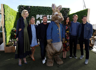 """Director of the movie Gluck poses with cast members Debicki, Robbie, Corden, Byrne, Gleeson and the character of Peter Rabbit during a photo call for """"Peter Rabbit"""" in West Hollywood"""