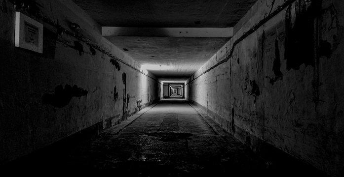 Dark Underground Tunnel with Lights Creating Depth