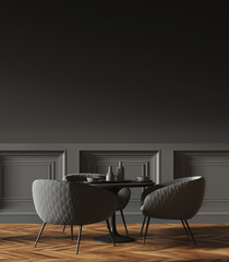 Black round table in a black wall cafe corner