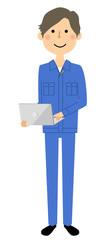 作業服の男性 ノートPC