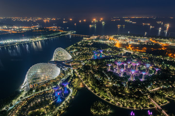 Aerial view to Cloud Forest and Flower Dome illuminated at night. Gardens by the Bay, Singapore city