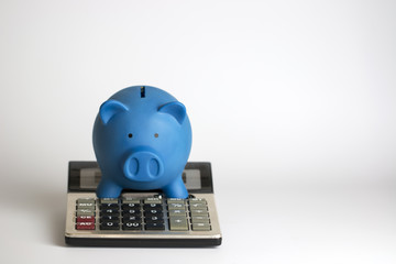 Calculator and piggy bank with euro bank notes