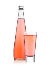 Bottle and glass of sparkling pink soda lemonade