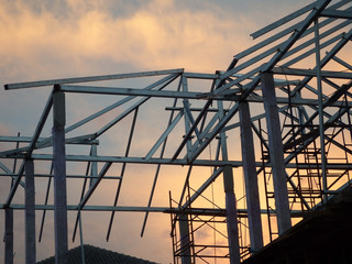 Silhouette of a metal roof frame on a new house under construction