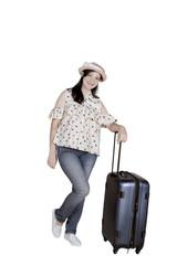 Female tourist holding a suitcase on studio