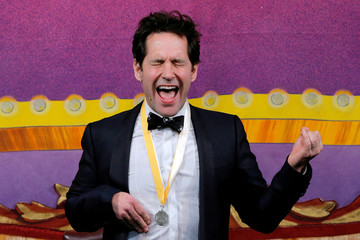 Actor Paul Rudd plays air guitar to a song by the rock band Rush during ceremonies to honor Rudd as Hasty Pudding Theatricals Man of the Year at Harvard University in Cambridge