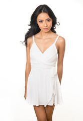 Beautiful woman's face wearing white dress