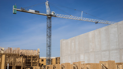 Crane towering over construction site