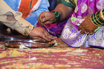Bride and groom at Haldi ceremony a couple days before a Hindu wedding