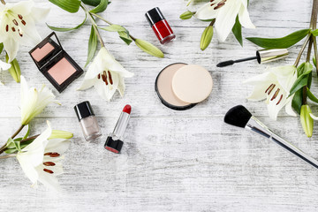 Top view of cosmetics and flowers