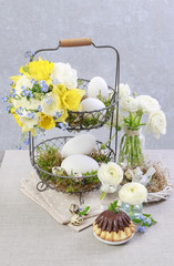Easter floral arrangement with yellow daffodils in wicker basket.