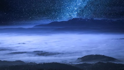 Fototapete - Stunning milky way and flowing clouds in the Tatra Mountains, Poland