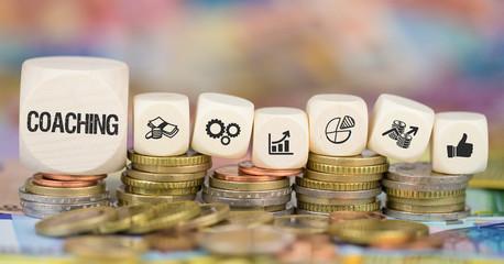 Coaching / Münzenstapel mit Symbole