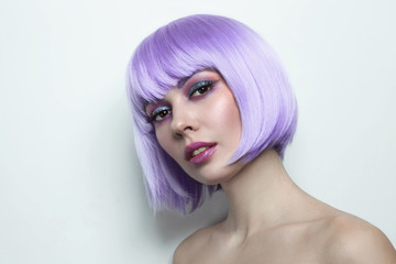 Young beautiful sexy girl with violet hair and fancy make-up