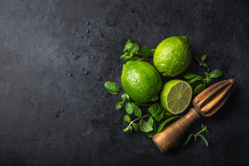 fresh green lime and mint on black background, top view, square image