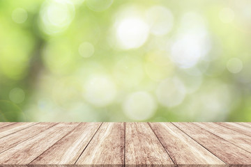Wood table top on blur nature background with spring or summer