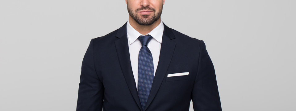 Young businessman banner on grey background
