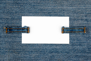 Empty business card with two jeans straps.
