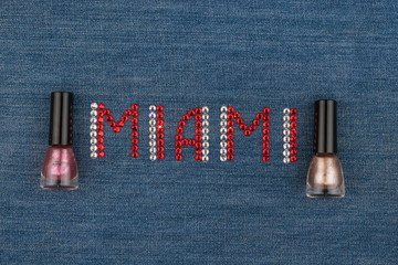 Word Miami, made of rhinestones, encrusted on denim. World Fashion.