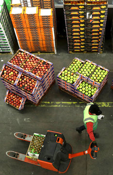 Fruit and vegetables sit on display at New Covent Garden wholesale market in London