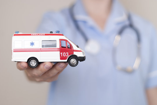 doctor and model of ambulance