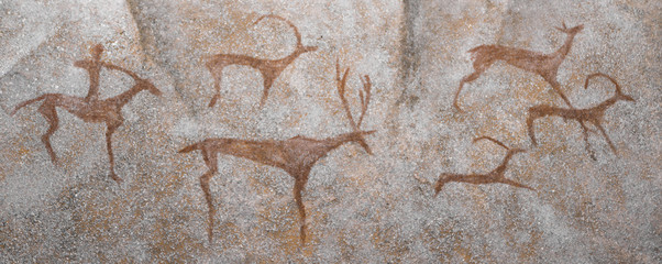 hunter is a historical animal depicted on the wall of a cave. archeology.