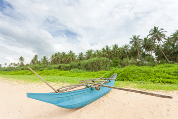 Balapitiya, Sri Lanka - A fishing canoe at the beach of Balapitiya