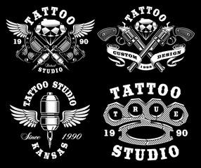 Set of monochrome tattoo emblems on dark background