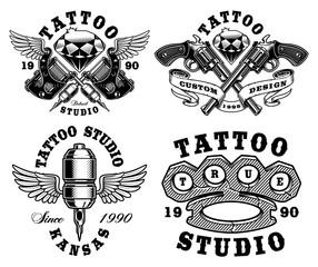 Set of monochrome tattoo emblems.