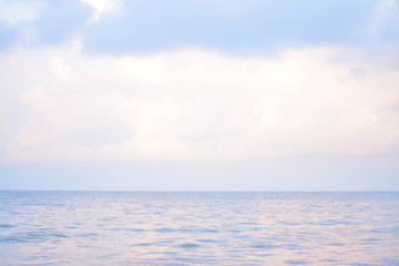 Deep blue and pink sea with cloudy.