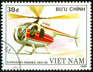 Ukraine - circa 2018: A postage stamp printed in Vietnam show Japanese multipurpose helicopter Mbb Bo 105. Circa 1988.