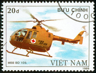 Ukraine - circa 2018: A postage stamp printed in Vietnam show German multipurpose and attack helicopter Mbb Bo 105. Circa 1988.