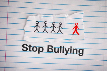 Stop Bullying. Phrase Stop Bullying on notebook sheet
