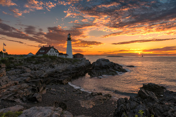 Sunset at Portland Head Lighthouse in Cape Elizabeth, Maine, USA.  One Of The Most Iconic And Beautiful Lighthouses.