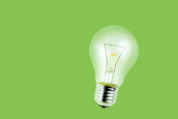 Light bulb on green background.