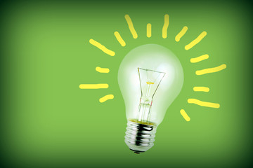 Light bulb on green background