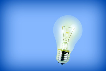 Light bulb on blue background.