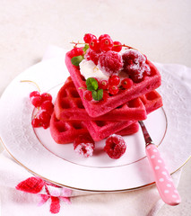 Red velvet waffles with berries