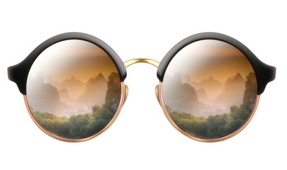 Sunglasses with reflection of cloudy mountains