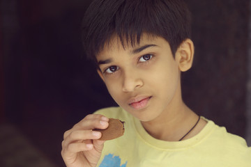 Indian boy eating a  Biscuits