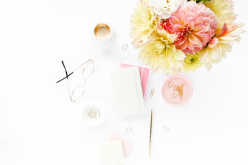 Home office desk. Woman workspace with yellow dahlias flowers bouquet, accessories, diary on white background. Flat composition for magazines, websites, media, Instagram. Flat lay, top view