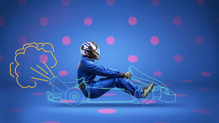racer in painted racecar on polka-dot background