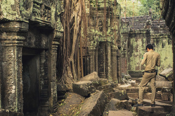 park ranger in Temple ruin, Angkor Wat, Cambodia