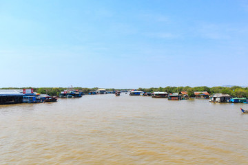 floating village and boats on Tonle Sap lake in Cambodia