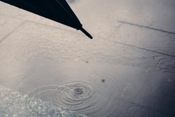 Rain concept.Umbrella close up on rainy road