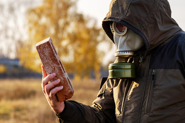 the man in the gas mask looks at the brick, a survey of dangerous infected objects careful examination