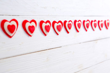 Garland of hearts on a wooden background. Valentine's Day