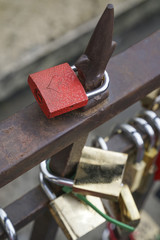 love symbol padlocks chained on bridge