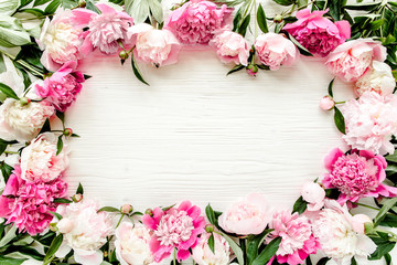 Foto op Canvas Bloemen Floral pattern, frame made of beautiful pink peonies on wooden white background. Flat lay, top view. Valentine's background. Floral frame. Frame of flowers. Flowers texture