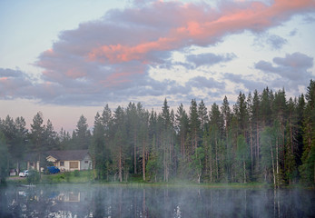 Foto op Canvas Ochtendstond met mist Sunrise of summer northern white night on small lake in forest